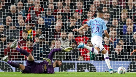NUMBER 2: Riyad Mahrez rounds David De Gea after a lovely pass from Bernardo to double City's advantage