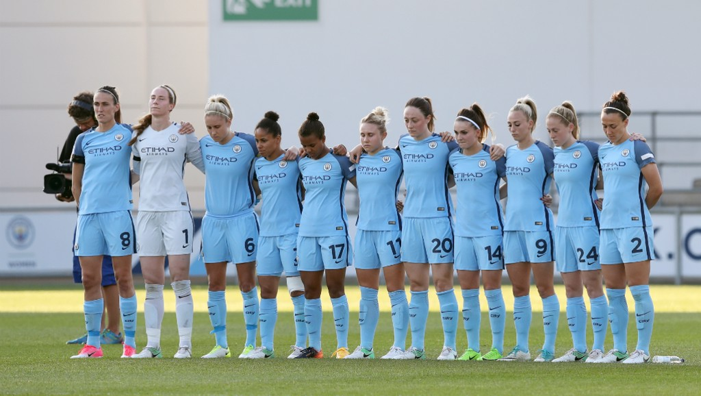 WE STAND TOGETHER: Players pause for a minutes silence prior to kick-off