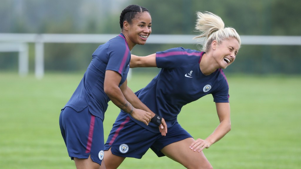 FUN AND GAMES: Demi Stokes and Steph Houghton joke around
