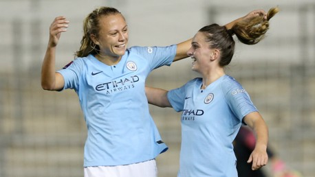 EMSLIE ELATION: Claire Emslie celebrates with Mel Lawley