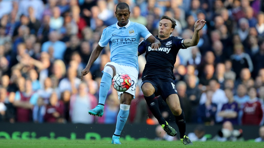 MIDFIELD BATTLE: Fernandinho goes head to head against Mark Noble