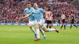 WHEELING AWAY: Nasri celebrates his spectacular goal in the 2014 Capital One Cup final.