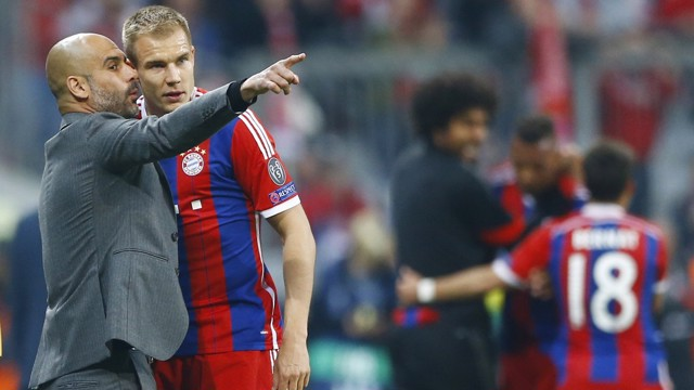 PEP TALK: Guardiola instructs Badstuber during their Bayern days