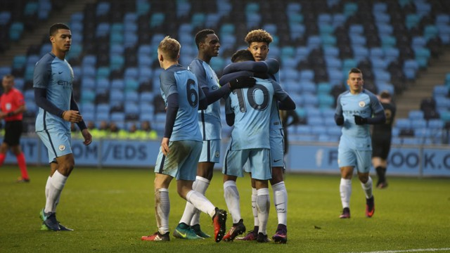 EQUALISER: Jadon Sancho and Paolo Fernandes celebrate after combining for City's second