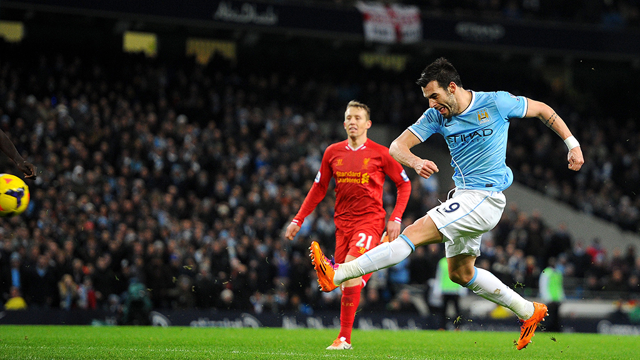 TRYING HIS LUCK AND SUCCEEDING: Negredo scores from long range against Liverpool in 2013