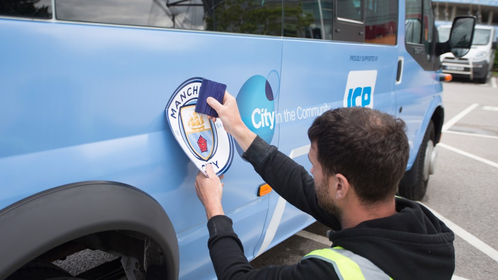 Another City in the Community bus is given a new badge makeover before travelling to local schools