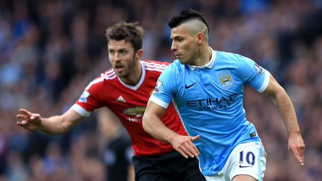 DERBY DUEL: Sergio Aguero and Michael Carrick go head-to-head