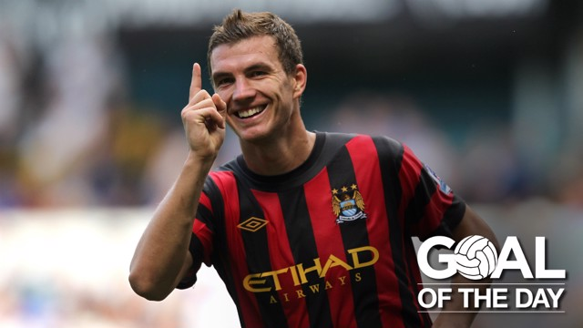 BOSNIAN BEAUTY: Edin Dzeko celebrates after smashing home a wonderful first-time strike
