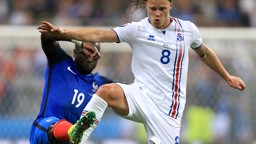 THAT BALL IS MINE: Bacary Sagna fights for possession against Iceland