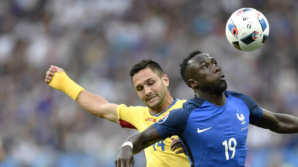 BACS TO THE WALL: Sagna in action against Romania
