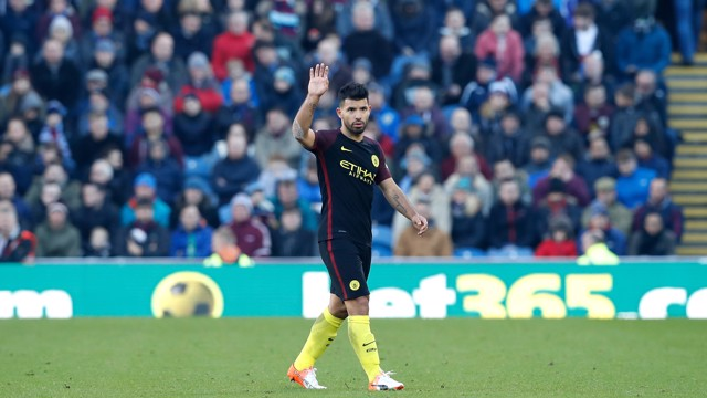 WAVE; Aguero waves to the City fans his two goal performance against Burnley at Turf Moor