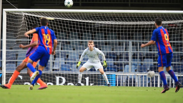 ALWAYS ALERT: Grimshaw reacts to a shot from distance during City's trip to Barcelona earlier in the UEFA Youth League