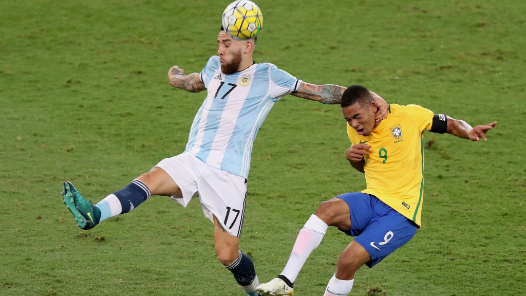 PLEASED TO MEET YOU! Nicolas Otamendi gets to grips with Gabriel Jesus