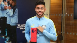 PROUD RECIPIENT: Fernandes smiles with his trophy for October's Premier League 2 Player of the Month