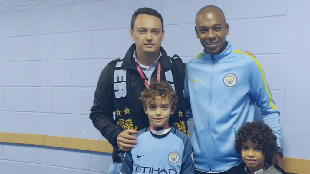 SMILE FOR THE CAMERA: Fernandinho and his son pose for a picture with Vitor and Cesar