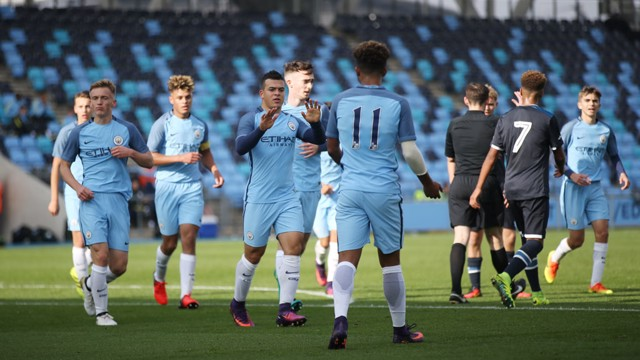 BACK ON TERMS: City celebrate Lorenzo Gonzalez's equaliser in the first half