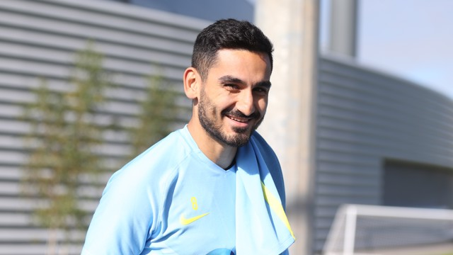 SMILEY: Ilkay Gundogan smiles for the camera at the City Football Academy
