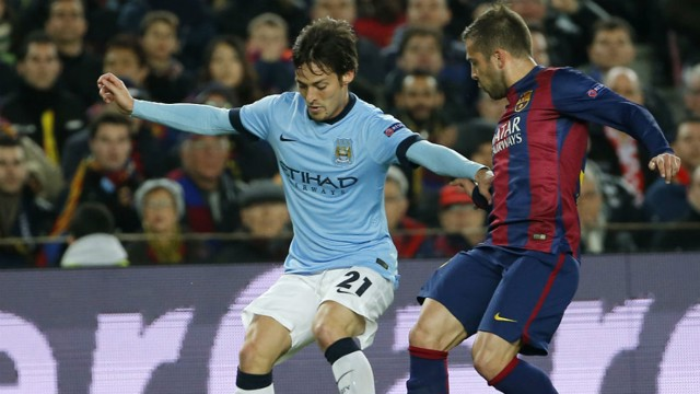 CLOSE MATCH: David Silva and Jordi Alba compete during the last meeting between the two sides