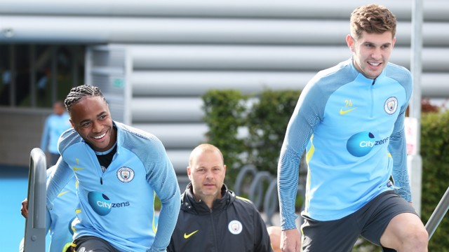 RARING TO GO: Raheem Sterling and John Stones head out to training