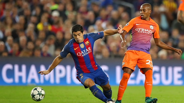 FALLING OVER: In an attempt to run on the ball, Suarez falls over under Fernandinho's pressure
