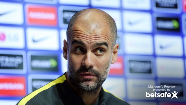 RAISED EYEBROWS: Pep Guardiola listens intensely to reporter questions