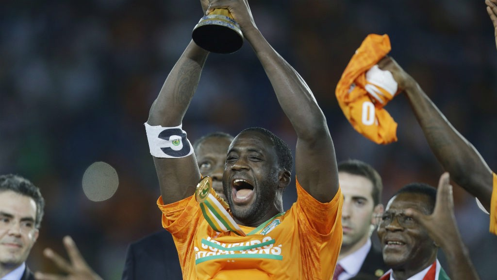 AT LONG LAST: Yaya holds the AFCON trophy aloft after finally getting his hands on it