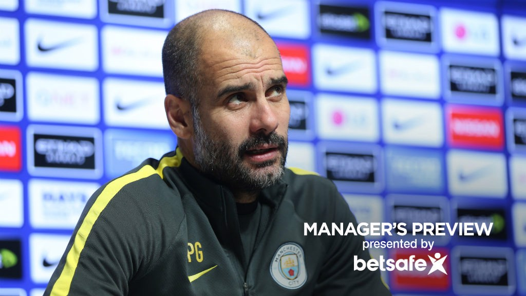 PEP: Manchester City's manager listens intently during his latest press conference