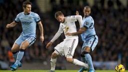 CITY TUSSLE: Fernandinho and Gylfi Sigurdsson come together during a match between the sides in 2014