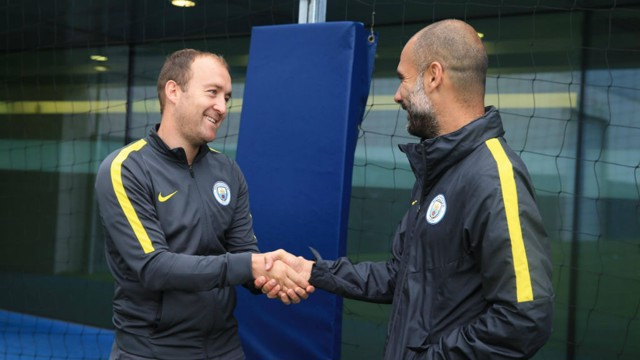 SHAKE ON IT: Pep Guardiola (right) congratulates Man City Women manager Nick Cushing