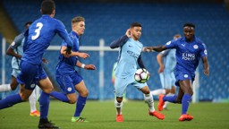 ALL AROUND ME: Fernandes is surrounded by Leicester shirts as he looks to get City back in the game