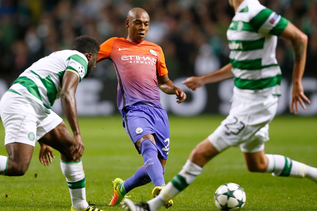 STRETCH: Fernandinho in full stretch mode as he passes the ball at Celtic Park
