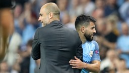 BOSSED IT: Pep Guardiola gives hat-trick hero Sergio Aguero a deserved pat on the back