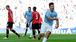 BACK OF THE NET: Sergio volleys City ahead in the 2013/14 Etihad derby