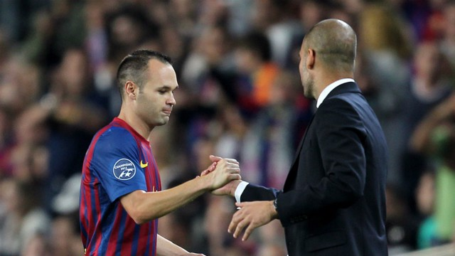 HANDSHAKE: Guardiola and Iniesta had a good working relationship at Barcelona