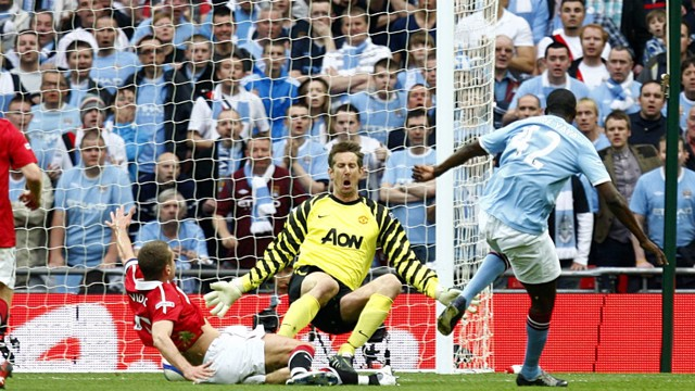 CLINICAL: Yaya Toure beats Manchester United goalkeeper Edwin van der Sar to put City ahead in the FA Cup semi-final.