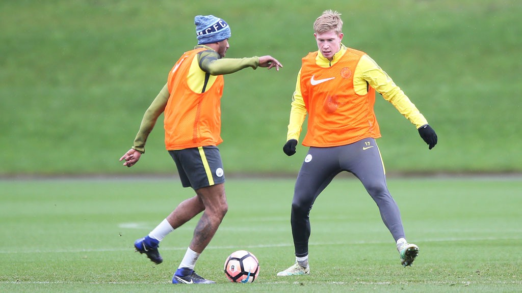 BACK IN MANCHESTER: Delph and De Bruyne back in action as the Manchester rain swoops down.