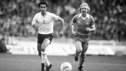 CITY AND SPURS: Gerry Gow and Osvaldo Ardiles chase the ball during a game between the two clubs