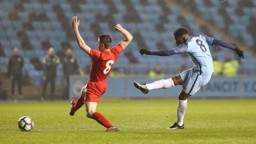 SHARP SHOOTER: Tom Dele-Bashiru has an effort from range after a good Manchester City move