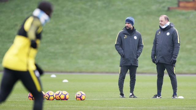 WATCHFUL EYE: Pep and Rodolfo Borrell preparing the squad for Saturday's game against Spurs.