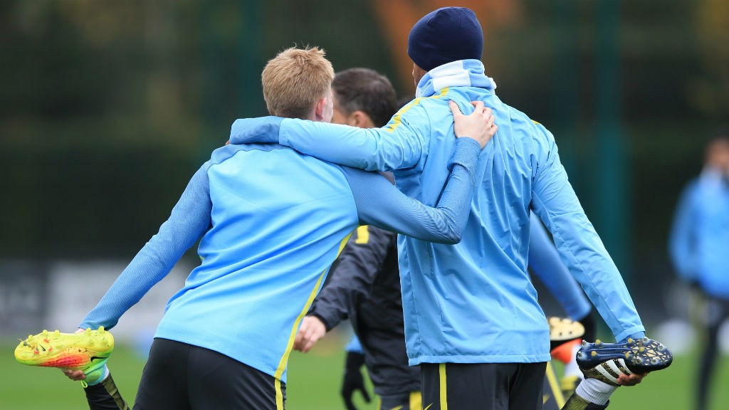 BELGIAN BUDDIES: Vincent Kompany and Kevin De Bruyne embrace during training
