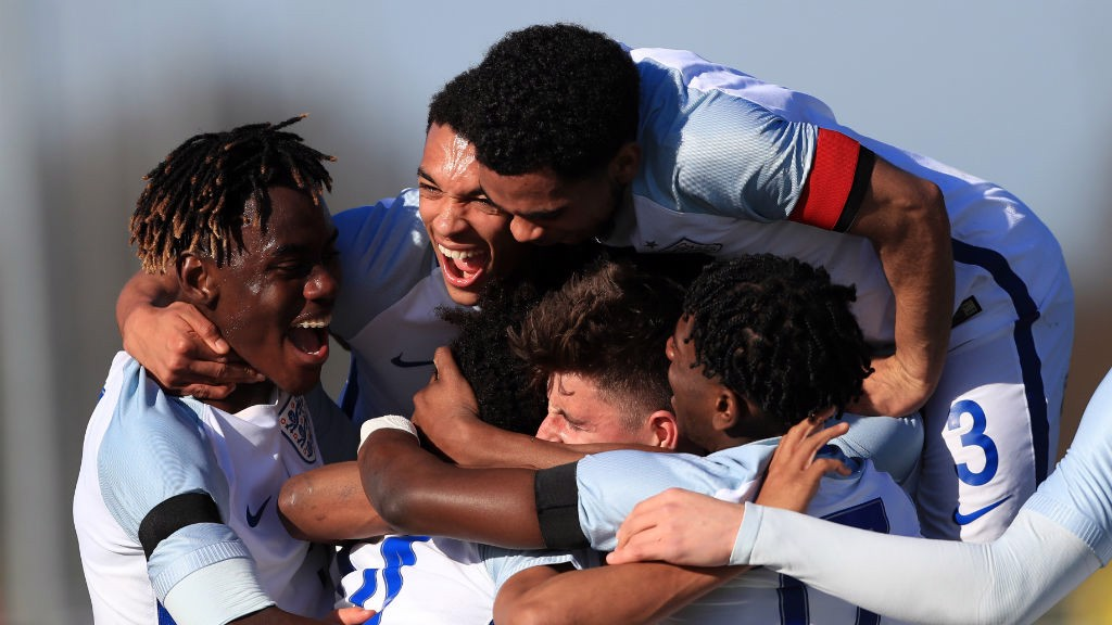 ENGLAND: Isaac Buckley-Ricketts joins in the celebrations with his England teammates