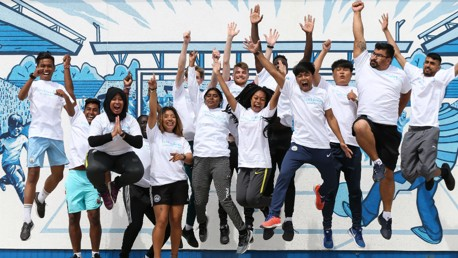 JUMPING FOR JOY: Some of our returning Young Leaders at the Community Wall at City Football Academy