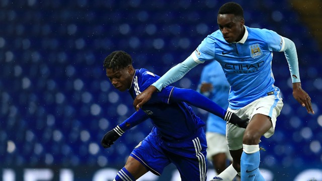 KONGOLO: Dutch midfielder battles for possession at Stamford Bridge.