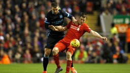 FRIENDS REUNITED: Aleks Kolarov battles with James Milner at Anfield