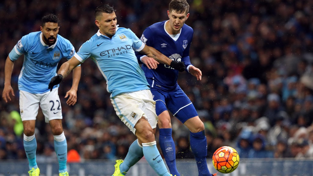 RUMOURED TARGET: John Stones (right) battling with Sergio Aguero