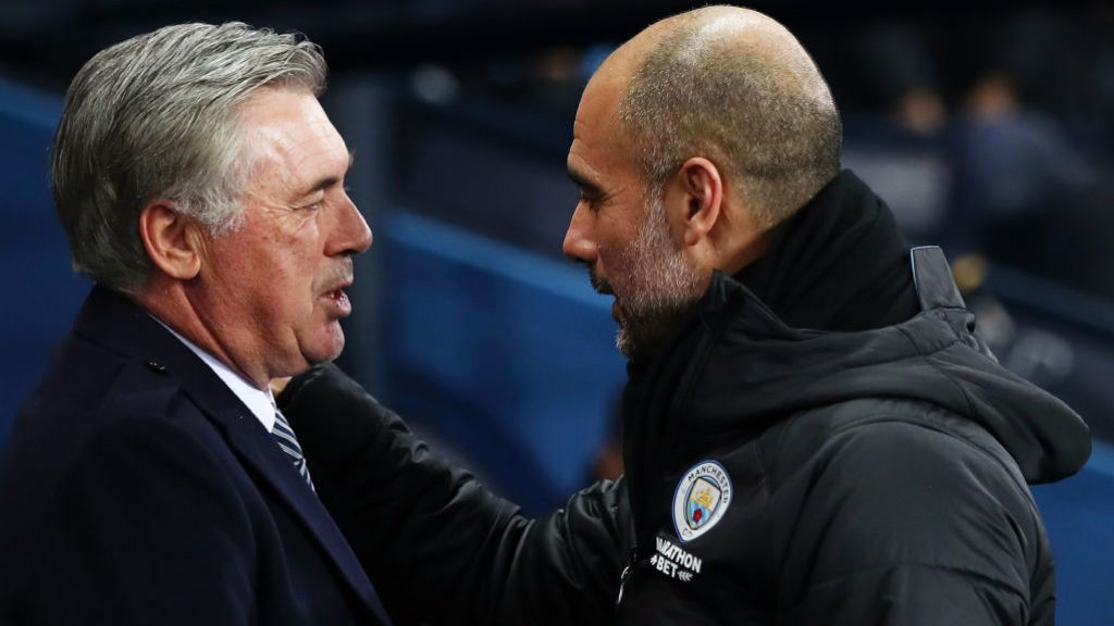FRIENDS REUNITED : Guardiola and Ancelotti share a warm embrace ahead of kick off_