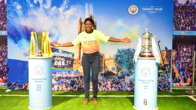 DOUBLE DELIGHT : With our women's team's Continental Cup and FA Cup trophies in Nigeria.