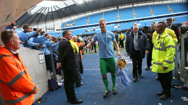 TROPHY : Hart brings the Premier League trophy into the tunnel after being crowned 2013/14 Champions!