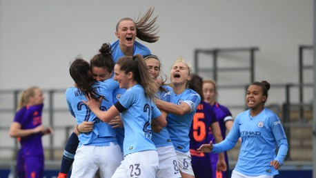 THAT WINNING FEELING: The Blues celebrate Jen Beattie's all-important last-gasp winner