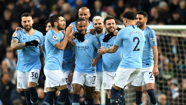 CENTRE OF ATTENTION : Raheem Sterling is mobbed after his crucial opener
